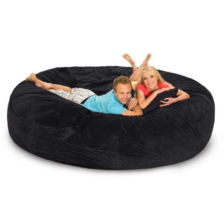 One word can sum up the 8 foot Relax Sacks Sofa / Bed - HUGE! Unlike traditional bean bag chairs that are filled with small beads, the 8 foot Relax Sacks black bean bag sofa / bed is filled with high quality, shredded foam to provide ultimate comfort. The huge bean bag can be used as a sofa and is also plenty large enough to also be used as a bed. The 8 foot Relax Sacks black bean bag Sofa / Bed is the ultimate bean bag crash pad!