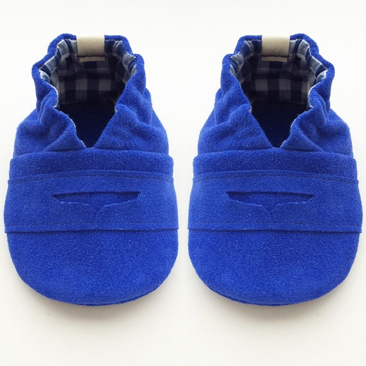 """Our Blue Suede """"penny loafer"""" in electric blue will surely stop traffic, so no need to worry about anyone stepping on your babe's blue suede shoes. Genuine suede leather shoes with a decorative, hand-cut penny slot are a cinch to put on and they stay put! Super cute blue / white check fabric lines the sides and upper. Little feet will appreciate the comfortable, elasticized ankle. A durable, leather sole allows for wear indoors or outdoors. Soft-soled shoes are rec..."""
