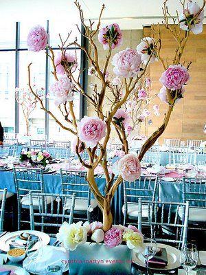 Paper flowers on branches centerpiece