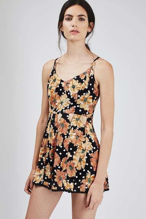 Look to floral prints and cut-out details for a so-now look. We're loving this easy to wear playsuit, featuring an all-over floral print, with triangle cut-out details to the waist. Finished with slinky straps and a cinched waist, simply style back with sandals for a festival-ready look. #Topshop