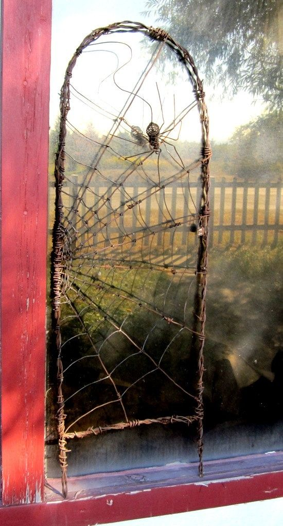 This would make a captivataing metal trellis for climbing plants. Spinning Spider In A Web Barbed Wire Garden Trellis