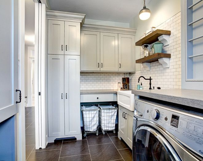 Interior Design Ideas - The laundry room cabinetry has a special place for the rolling laundry carts.  CVI Design.