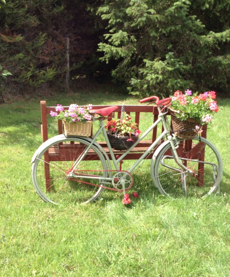 My dad's sister black bike over 60yrs old . Painted metallic sage green now on display  in my garden