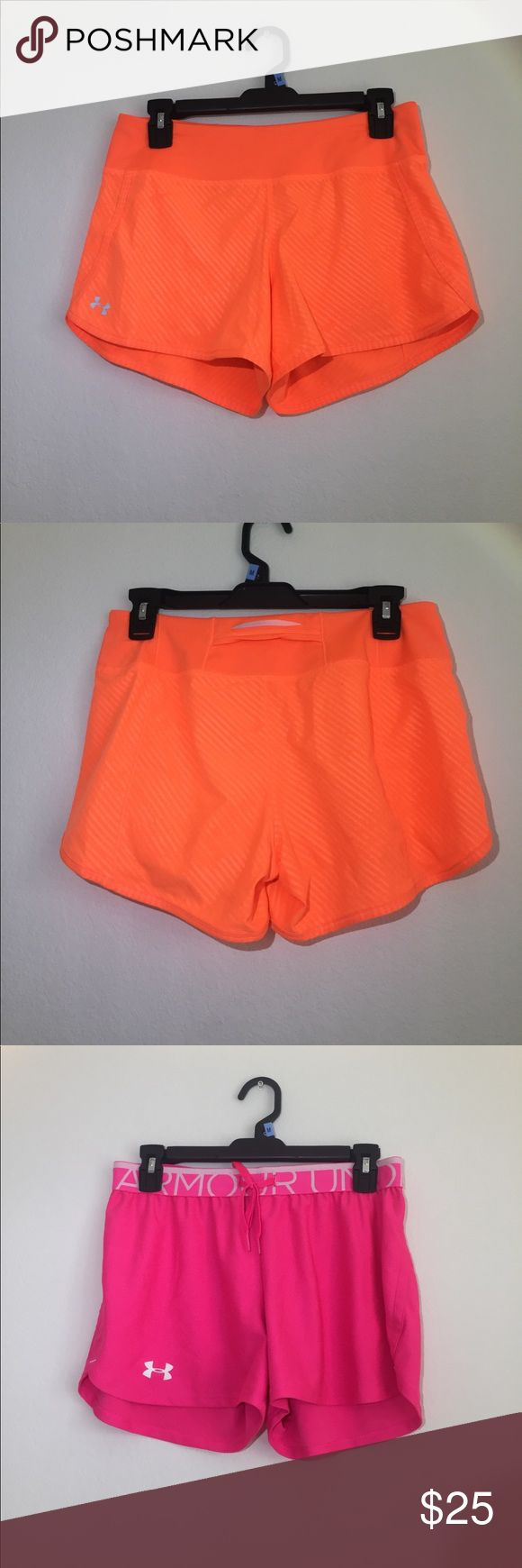 Neon athletic shorts 3 pairs of athletic shorts- two Under Armour and one Champion. Orange UA has mesh underwear attached underneath and a pocket in the waistband. Pink UA has a drawstring waistband and is loose fitting. Pink Champion had white paneling and orange trim, also with underwear attached underneath. Pocket inside. Originally around $40 each. Selling all three for $25. Shorts