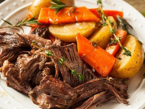 A recipe for Waterless Pot Roast made in the crock pot made with pot roast, onion, onion soup mix, , carrots