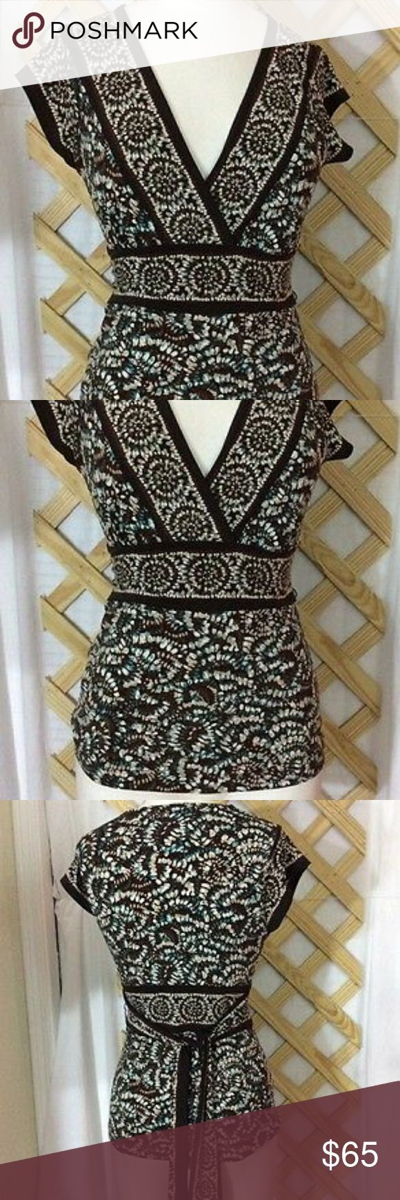 BCBGMaxAzria Top, EUC! Available July 1st, 2017 BCBGMaxAzria Top, Excellent pre-owned condition. The colors are GORGEOUS!! Brown, teal and white. Cute tie back as you can see in the pictures.  PLEASE NOTE:  **It will be available to ship on Saturday, July 1st so if you want to purchase please be aware of that**. Thanks! BCBGMaxAzria Tops Blouses