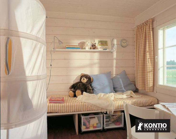 Chambre d'enfant dans une maison en bois Kontio.