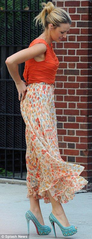 Tangerine dream: Blake Lively in a colourful maxi skirt and orange blouse paired with towering teal stilettos