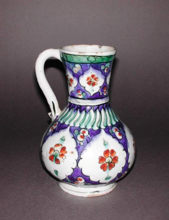 Maker: Unknown; potter Category: fritware (stonepaste) Name(s): jug Islamic pottery; category Iznik; category Date: circa 1580 — circa 1600 School/Style: Ottoman Period: late 16th Century