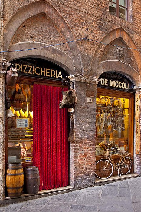Meat and Cheese shop along a narrow street in Siena Tuscany Italy by Brian Jannsen Photography