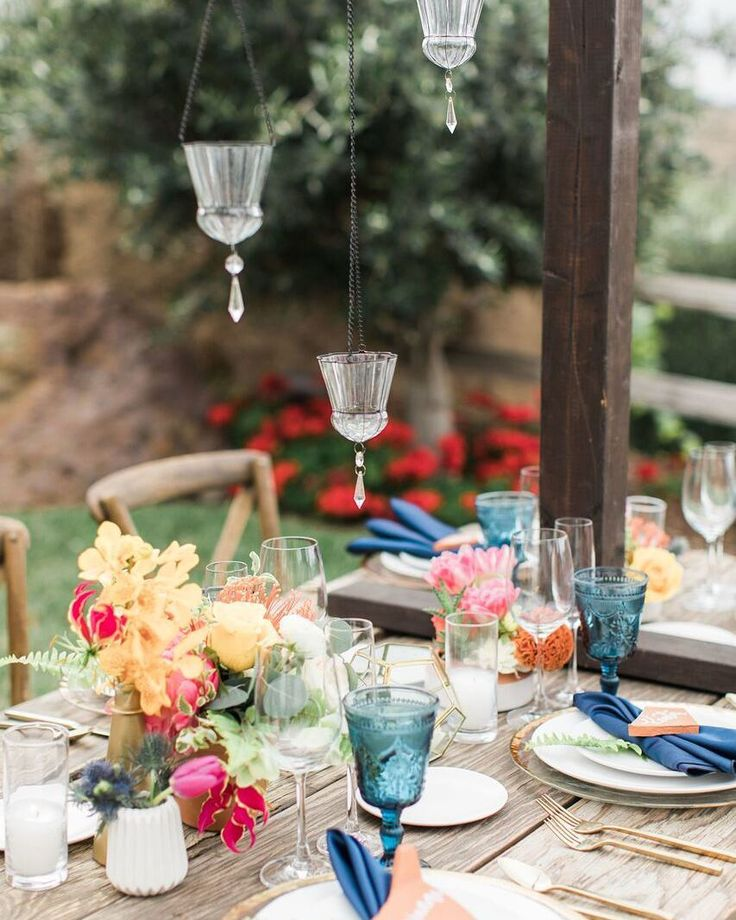 What a beautiful combination of textures and colors for this table setting! Our Brushed Gold Flatware Bella Blue Goblets and Gold Rimmed Chargers and bright florals by @lotusandlilyfloral were beautiful additions || Design  Planning: @starhansenevents @kristeenlabrot || Venue: @cielofarms | Signage/Calligraphy: @kelly_patrice | Tabletop: @premiere_rents | Tequila: @codigo1530 | Catering: @contemporarycatering | Florals: @lotusandlilyfloral | Photography: @jennyquicksall | Specialty Cake…