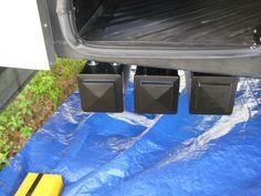 PVC fence posts bolted to under-carriage to use as storage for sewer line hose etc. Post caps are hinged. Full How-to.