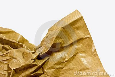 A background of a closeup of creased old brown parcel paper