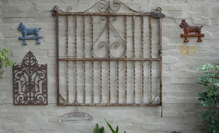 Old gates make fine wall art as well as security bars on sliding sash windows.