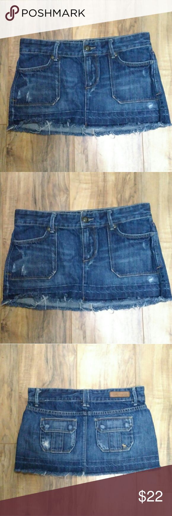Abercrombie and Fitch Mini Skirt Abercrombie and Fitch distressed blue jean skirt with stylish fades and Fringed ends. Has classic A&F buttons.  Measures 10 inches from top of jean to bottom of jean and approximately 29 inches around. Abercrombie & Fitch Skirts Mini