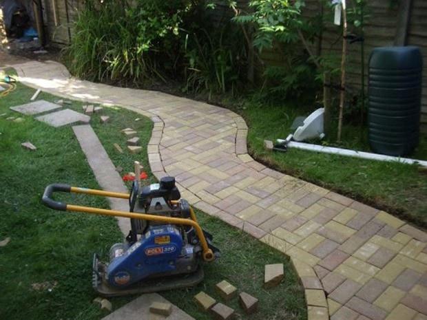 28 Garden Pathway Ideas: concrete and brick path photo
