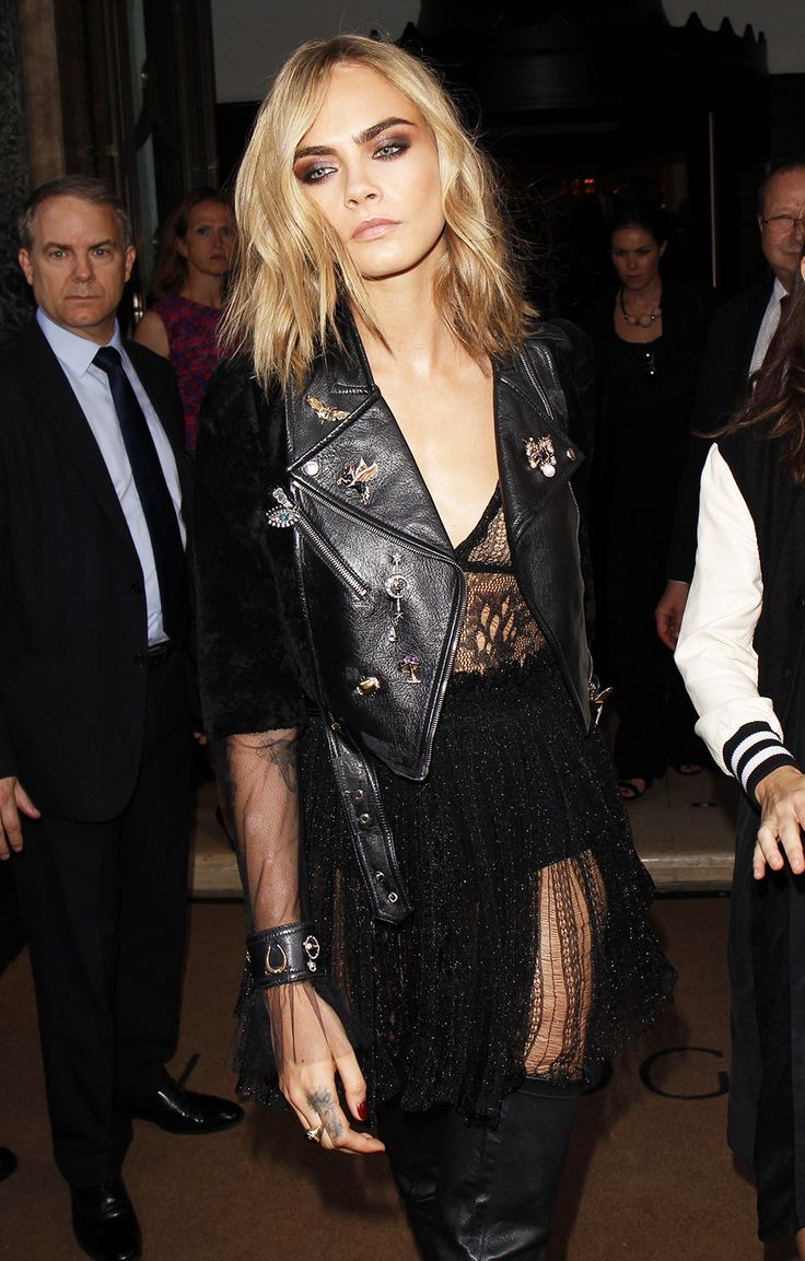Avert your eyes from Cara's show-stopping eye glam for one moment to appreciate her array of wickedly witchy duds. A laddered lace dress, complete with tulle sleeves, teamed with a heavily-pinned biker jacket. Oh, Cara Dele-dream.