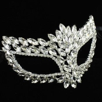 "A full bejeweled mask is all the rage at any masquerade party. Held by black satin ribbons at approximately 44"" wide and 6"" in height."