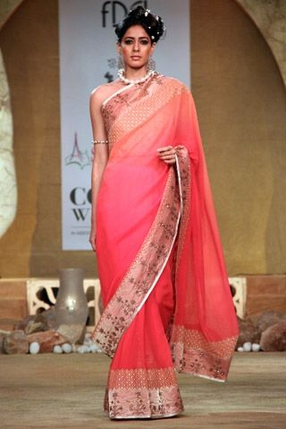 You can never go wrong in the ever classic sari such as this peach number by Kotwara – it's conservative yet fun