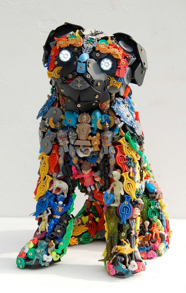 Robert Bradford Bradford, a former psychotherapist, is best known for creating sculptures from toy parts. He screws the toy parts onto a wooden armature to create his 3D sculptures.