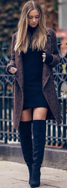 Black dress, black high boots, with a coat on top