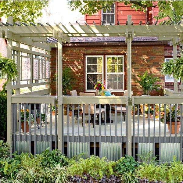 Add flair and function to a basic builder's deck with these tips for an affordable facelift. These seven tips will help you stay on budget, introduce some color, and add privacy.