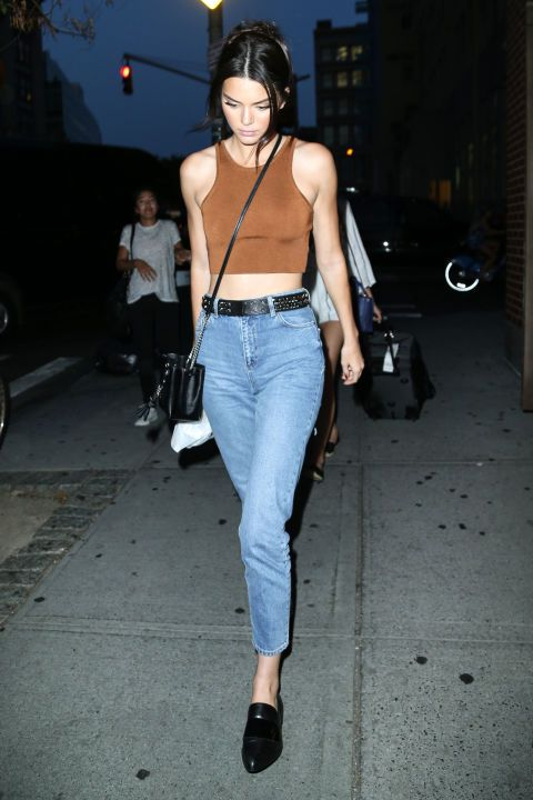 The model is no stranger to repeat looks and these high-waisted mom jeans are definitely on her list of favorite pieces. Jenner has been spotted in her $70 Topshop denim three times this summer.