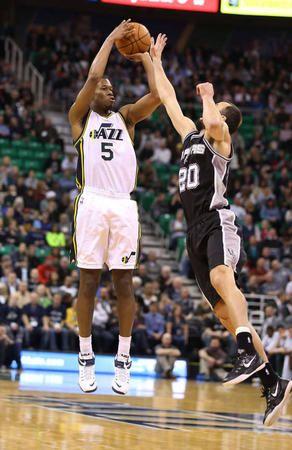 Utah Jazz guard Rodney Hood (5) shoots over San Antonio Spurs guard Manu Ginobili (20) as the Utah Jazz and the San Antonio Spurs play NBA basketball Tuesday, Dec. 9, 2014, in Salt Lake City.    (Tom Smart, Deseret News)