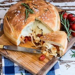 Freshly baked home made bread stuffed with caramelised onions, roasted tomatoes, some grilled peppers and two cheeses.