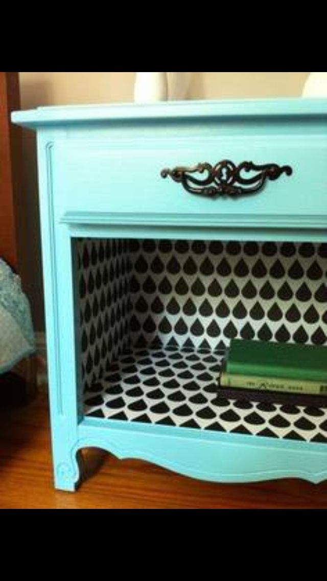 Take an old table, remove the bottom drawer and wallpaper the inside!  It's a whole new piece!
