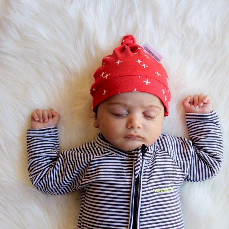 ❌❤️The Flynn Newborn Top-knot Beanie❌❤️ Red 100% cotton jersey with white cross print. Depending on head circumference this beanie is for babies up to 4 months of age. Available online now.