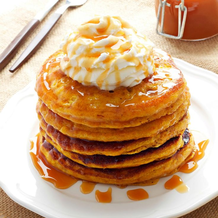 These Pumpkin Spice Pancakes are a delicious fall breakfast! Made with fresh buttermilk, pumpkin and topped with caramel and whipped cream!