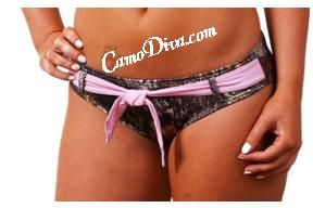 Pink Belted Camo Swim Bottoms - You'll love this Mossy Oak Swim Suit. Unbelievabley cute and well fitting camo swim bottoms. Attached pink belt is a great accent. Poly/Spandex Fabric. Juniors sizes run small. All Mossy Oak Swimwear is mix and match. Pastel Pink.