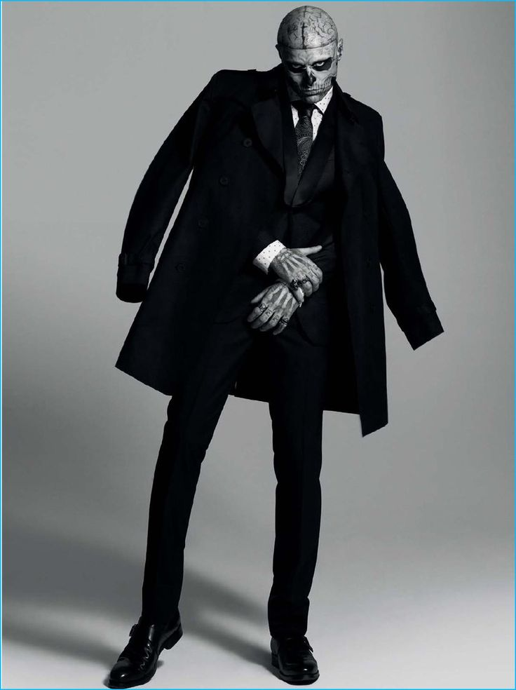 Rick Genest pictured in a Hugo Boss trench coat and trousers with a J.Lindeberg blazer.