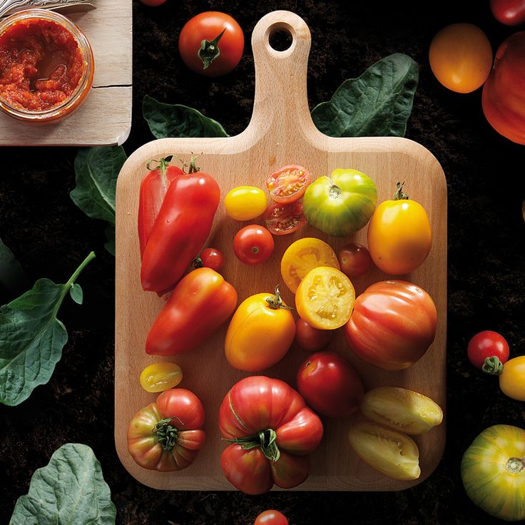 All tomatoes (no matter what shape or shade you are) aboard! A chopping board. Foodies are waiting.  #tomato #tomatoes #vegetables #red #yellow #green #chopping #board #nature #garden #tapenada #culinarystories #story #tale #food #foodphoto #culinaryphoto #foodstyling