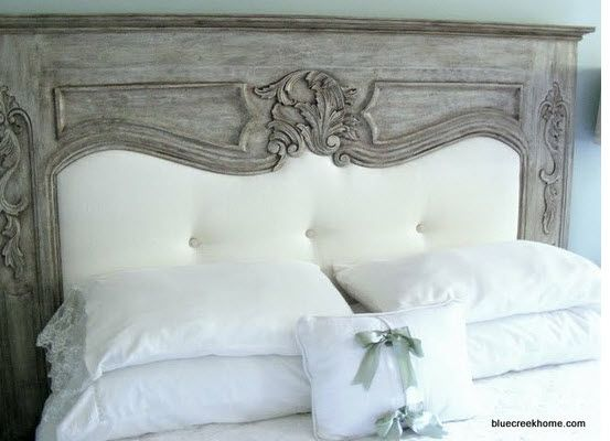 Headboard is a an old fireplace mantle with the center upholstered piece being added
