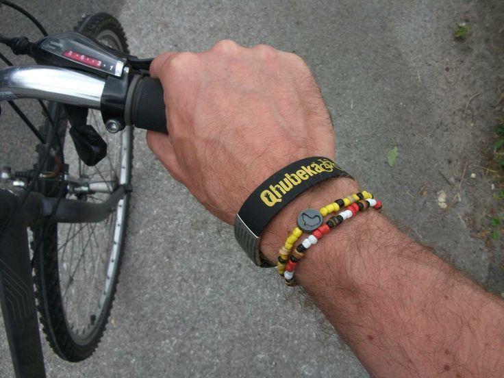 Qhubeka's ICE (In Case of Emergency) ID bracelet and @beadcoalition Cycle Force bracelet. www.beadcoalition.com