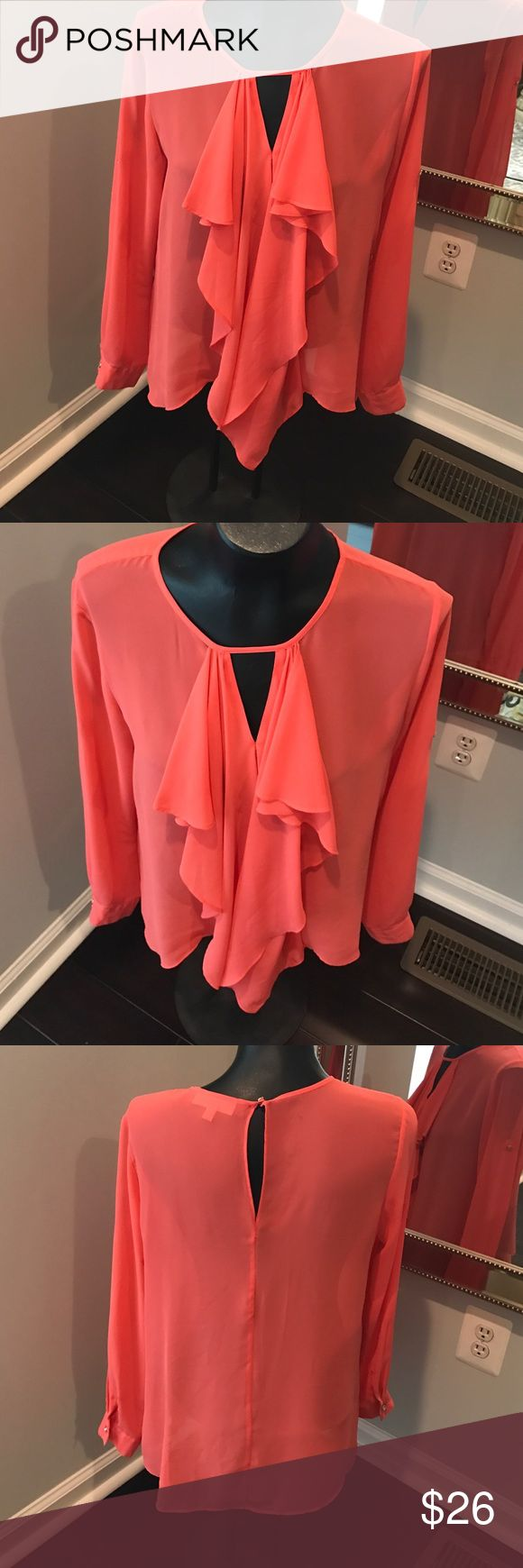 Coral blouse with front ruffles >Quick description: coral blouse with front ruffles. Sleeves can be rolled up with button tab >Color: coral  >Condition excellent ♦️Make offer through the Offer Button♦️As I will only be accepting reasonable offers through the offer button.  Please ask any questions before buying as all sales final.  Or if you prefer to bundle to pay one shipping charge. 20% off two items 30% off 3 items or more. 🚫No Trades or 🚫PayPal accepted😃 ALL ITEMS COME FROM SMOKE…