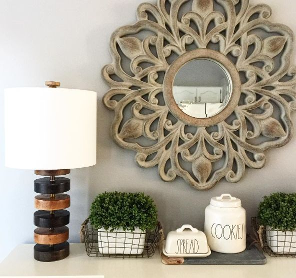 A simple sunburst mirror in an entryway freshens the space