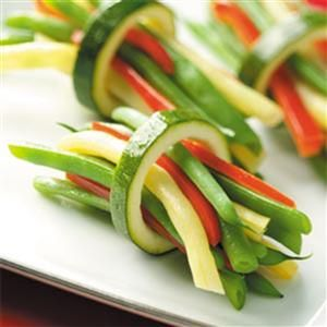 Festive Bean 'n' Pepper Bundles Recipe -This is a beautiful, interesting way to prepare vegetables for a holiday dinner. The flavor pairs well with a variety of entrees. —Judith Krucki, Lake Orion, Michigan