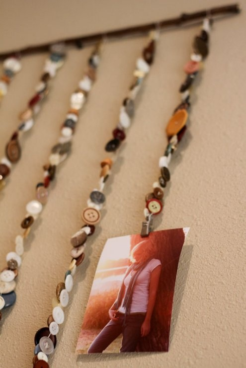 hanging photos from strings of buttons :)