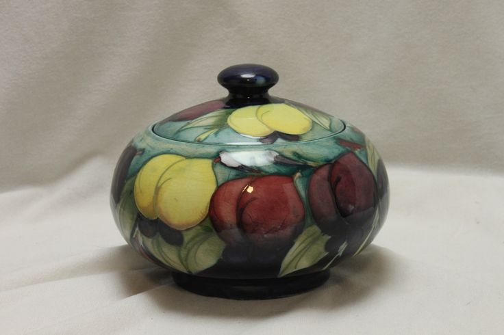 A very pretty lidded bowl decorated with Moorcroft's Wisteria pattern, dating from around 1925. www.chinaroseantiques.com.au