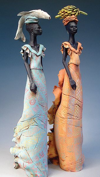Annie Peaker, Artist, figures with fish & bananas, 65cm Tall
