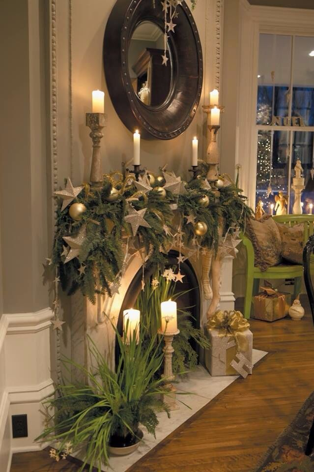 Live plants, stars and other Christmas decorations make this mantel a focal point. The candles light it up and add romance and elegance. Beautiful.: