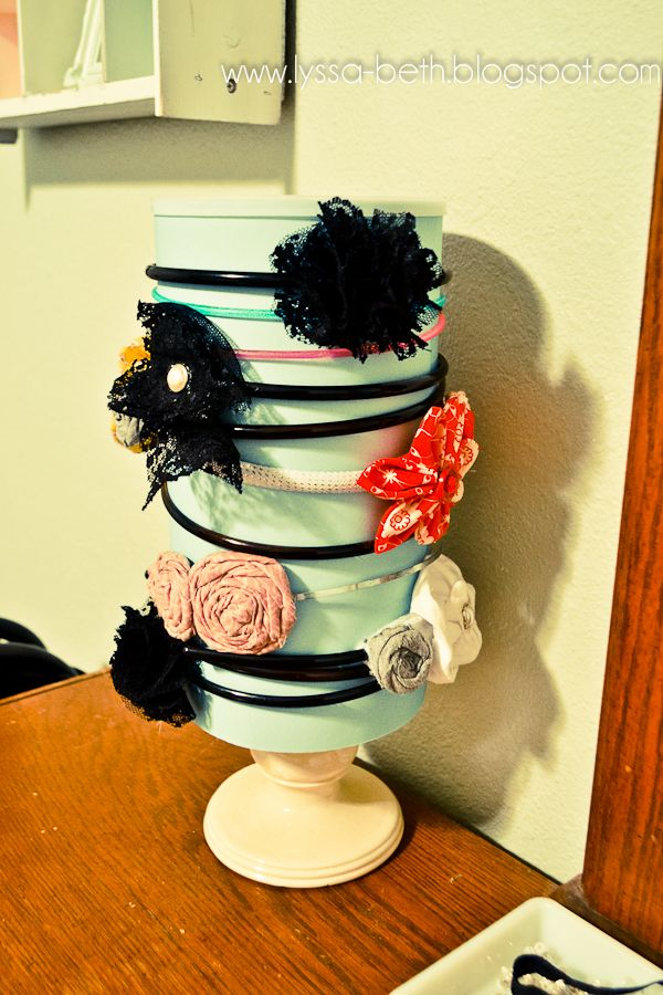 Headband organizer made out of oatmeal can. And all the elastics and brushes go inside. Love this!
