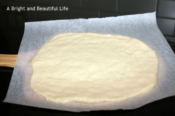 We think this is The Best Pizza Dough recipe ever. It's crusty on the outside, soft and slightly chewy on the inside and rises and bakes up perfectly.