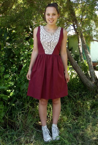 MAROON FIT & FLARE DRESS WITH LACE INSERT AND TRIANGLE CUT-OUT ON BACK from www.daredarla.com