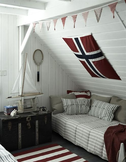 This is a lot like what my bedroom in Norway looked like.  With the daybed and the slanted roof.