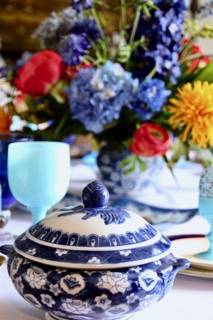 Tradtional_home_Easter_tablescape_setting_table_round_color_modern_mix_floral_arrangement_cobalt_delft_blue_dinnerware_dining_room_tureen_vintage