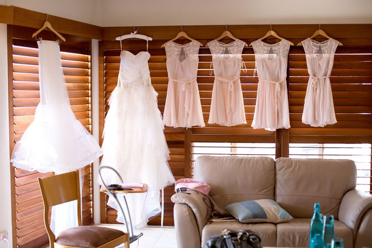 Wedding dress hanging over window, Noosa wedding. www.lanicarter.com